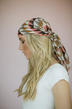 Women's Bohemian Printed Tie On Style Headscarf or Hair Wrap with Frayed Edges and Triangle Pattern in Coral
