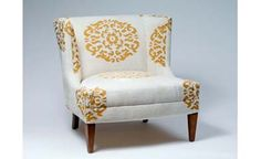 Image from http://www.cnbhomes.com/wp-content/uploads/2015/01/precious-weinrib-club-chair-white-AWESd.jpg.