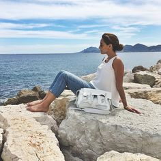 When she was in Cannes for the famous Cannes Film Festival, French fashion blogger Kenza rocked our Paquita top while taking a break on the beach. Thank you  for this amazing mini-photoshoot! larevuedekenza.fr www.annefontaine.com #annefontaine #fashion
