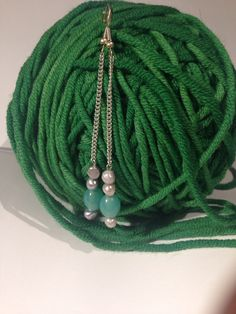 Green glass and silver pearls
