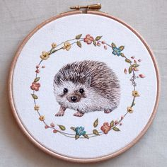 "I've just finished this 7"" hoop of @mrstiggiewinkle_ !! This was my first commission and I can't wait to post the hoop to its lovely new owner - @carolinetwohillphotography !! I hope you like it Caroline! :) #embroideryhoop #embroidery #hedgehog #mrstiggywinkle #hoopart"