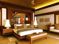 Thai and Southeast Asian styles are influenced by Chinese design but are uniquely their own. Thai style features a lot of ornamentation and gold leaf, bright colors and silks. Indonesian style is similar, but toned down and features darker woods. This hotel in Bali demonstrates a restrained and elegant Southeast Asian interior in a neutral palette