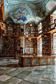 Carved-wood bookcases and a ceiling fresco dominate the Baroque library of the St. Florian Monastery, in Austria.: Most spectacular libraries in the world slideshow