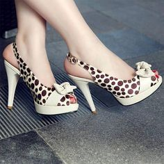 Polka dots and bows! Love these shoes :) looks like a comfortable heel as well
