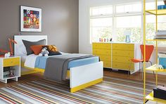 Paint a focal point wall in your kid's bedroom! Grey and yellow are unexpected in a kid's room but so fresh!