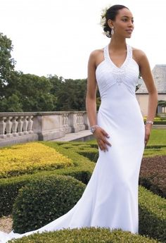 Look absolutely alluring and stunningly statuesque in this halter wedding dress that conveys all the ideal qualities that you would hope for in the perfect dream dress. After all, your wedding is one of the most cherished days of your life, so go all out in pure style! You'll love this dress as it features a luxe chiffon fabric with beaded, plunging v-neckline and shirred bodice along an empire waist. Other sweet aspects include a sheath silhouette that ends in a breathtaking chapel length…