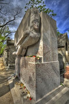 Paris Cimetière du Père-Lachaise | Oscar Wilde before they put up a perspex barrier to stop people from kissing it.
