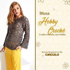 Os motivos florais dão um toque delicado a esta blusa confeccionada com o fio Hobby