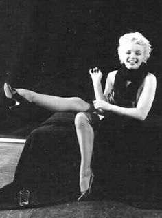 Marilyn. Black sitting. Photo by Milton Greene, 1956.