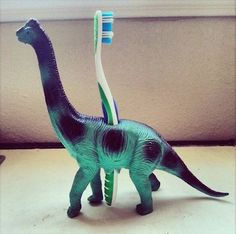 Dinosaur Toothbrush Holder Great idea for a little boys bathroom!Great idea for a little boys bathroom! Diy For Kids, Crafts For Kids, Baby Crafts, Plastic Animals, Plastic Animal Crafts, Activities For Kids, Baby Kids, Kids Room, Child Room