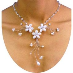 Garden Medley -- White Pearl    Three perfect gemstone flowers are the feature of this dazzling necklace, while Swarovski crystals and Japanese beads thread a circular band to realize the look of this magnificent piece.