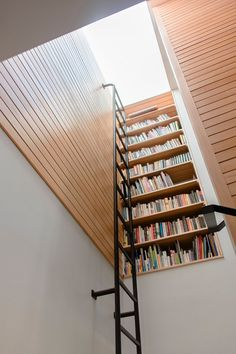 Vertical #bookcase at stair landing #ladder #stairs #hiddenlibrary #top5