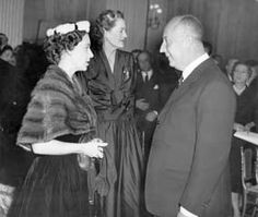 Princess Margaret meets Christian Dior at Blenheim Palace for the preview of Dior's 1954 collection, November 1954. (topfoto.co.uk)