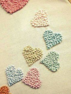 Just French knots.  Hearts, embroidery ideas.