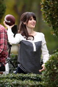 Zooey Deschanel playing a game of catch with co-star Steve Howey on the set of 'New Girl.'