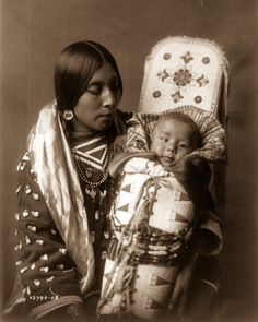 An expansive photo record of Native American life in the early 1908 An Apsaroke mother and child. Image: Edward S. Curtis/Library of Congress1900s