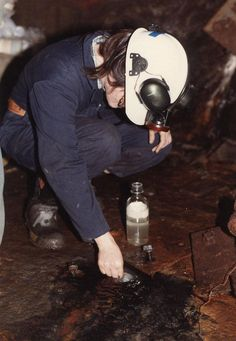 A scientist takes a sample of water from a mine deep underground in Ontario, Canada. The water turned out to be 2.6 billion years old, the oldest known water on Earth. B. Sherwood Lollar et al.