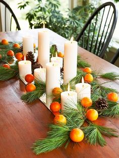 Display white pillar candles en masse along a mirrored table runner. Fill in the centerpiece with fragrant greenery boughs, small oranges or kumquats, and pinecones.