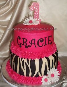 Zebra print cake, adorable for a little girl. I want it for myself, I LOVE zebra print :)