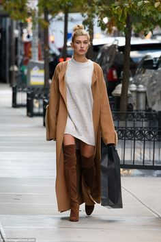 Perfect model: Hailey Baldwin used the streets of Tribeca as her very own runway on Monday...