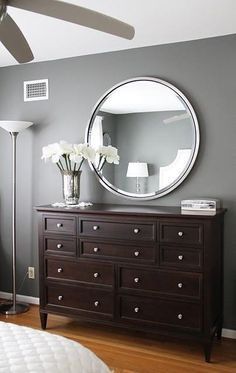 Main bathroon colours, med. grey, caramel logs on window wall, white to cream floor, dark vanity. Frame Mirror with rusutc wood or greyed barn look wood.