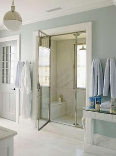 spa-like bath. marble shower with vented door, and hicks pendant | steven gambrel