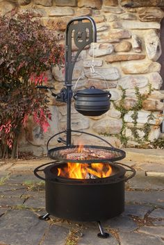 Find out how smoke less fire pits work and see how you could take your backyard grilling experience to a completely new level! Cooking Over Fire, Fire Pit Cooking, Fire Pit Grill, Gas Fire Pit Table, Fire Pit Area, Fire Pit Backyard, Fire Pits, Garden Fire Pit, Bbq Grill