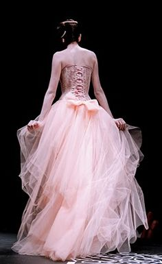 Corset gown. Would make a show stopping wedding dress! But not in this color bleh...