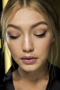 Spring 2015 beauty - It was classic Dolce & Gabbana beauty at the fashion house's show, with Pat McGrath creating warm, luminous skin and feline eyeliner flicks on every model.