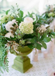 Centerpieces in shades of green -- See more on SMP: http://www.StyleMePretty.com/2014/05/22/modern-meets-rustic-in-wyoming/ Photography: CarriePattersonPhotography.com