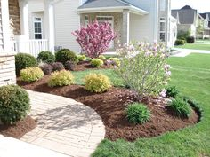 Simple Front Yard Landscaping Ideas. Notice the grouping of threes here...always works beautifully!