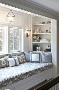 Window seat decor. Lots of pillows coordinated with the homemade cushion cover. To do list!