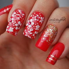 Red nails with flower stamp design