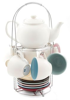 This Time Tea-morrow Set, #ModCloth I adore this. It includes a teapot, teacups, and saucers. It would be wonderful for entertaining. The colors used are very nice.