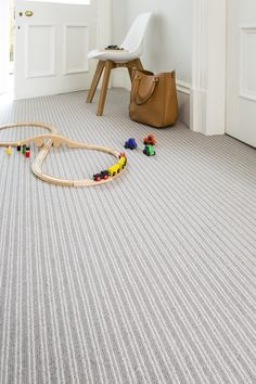 The beauty of textured or striped wool carpets is that they add an extra dimension to a living space. Plain neutral carpets have been popular for many years but many people want to enrich this look with a tempting texture or simple stripe to make the floor a real feature. #carpets #flooring #greycarpets #greyflooring #greyinteriors #greylivingrooms #neutralcarpets #neutralinteriors #neutrallivingrooms #interiorinspiration #greybedrooms #neutralbedrooms #stripedcarpets