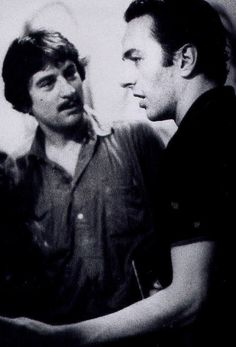 Robert De Niro and Joe Strummer.  Greatest actor meets greatest musician.    They both had mohawks at one time so thats obviously the key to success.