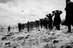 German prisoners of war are led away by Allied forces from Utah Beach, on June during landing operations at the Normandy coast, France D Day Normandy, Normandy France, 4th Infantry Division, Utah, D Day Invasion, D Day Landings, Haunting Photos, Prisoners Of War, Interesting History