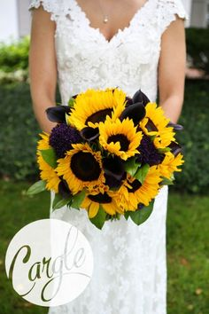 Summer bridal bouquet of yellow sunflowers and plum calla lilies. Www.floralvdesigns.com