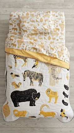Catching a glimpse of your favorite wildlife has never been easier, thanks to the roaming herd on this animal toddler bedding set. Our Menagerie Toddler Bedding is adorned with countless illustrated animals in a stylish black and yellow color palette. Baby Laden, Baby Store, Kid Spaces, Kids Decor, Linen Bedding, Bed Linens, Baby Bedding, Boy Room, Kids Furniture
