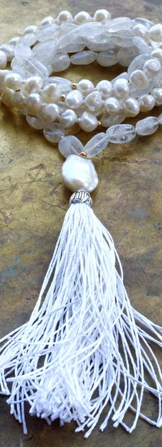 A pure white bridal mala of pearls and moonstone with a pure silk tassel and baroque pearl.... at The Pillow Book