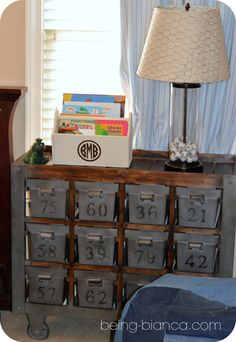 Easy DIY for boy bedroom. Used a toolbox style Easter basket with a coat of paint + monogram to hold books. Tons of projects in this space!