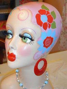 Looks like a bathing cap painted mannequin
