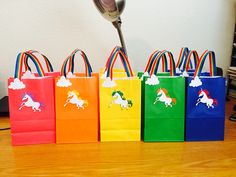 Rainbow unicorn party favor bags                                                                                                                                                                                 More