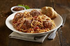 Jumbo Spaghetti and Meatballs - Housemade meatballs made with a blend of ground beef and Italian sausage, tossed with an herb tomato sauce, garlic, red pepper flakes and fresh basil and finished with Parmesan cheese.