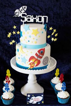 Outer space birthday party cake and cupcakes! See more party planning ideas at CatchMyParty.com!