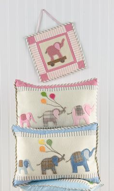 "From Bunny Hill Designs-Elephant Walk:  12"" x 17"" pillow and 8"" x 10"" mini wall quilt. Wool applique designed especially for the nursery! Make this pillow in pink or blue and then add the little wall hanging to go with it. Baby's nursery will be cute as can be! Pattern includes basic directions for wool applique  Price: $9.95"