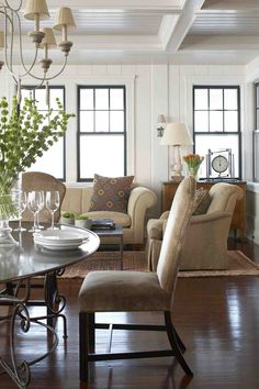 Beautiful paneled walls, coffered ceiling, wood floors, white walls with black window trim... New England Cottage