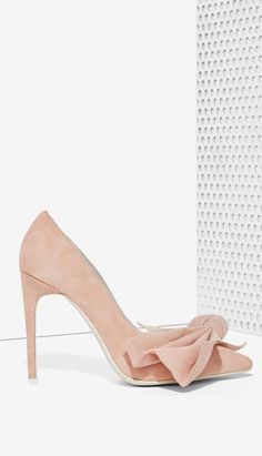 Blush bow pumps