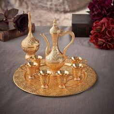 Latest Model Gold Color Moroccan Tea Cups Set Height: Turkish Coffee Cup: 4 cm, Ewer: 20cm Diameter:Tray: 25 cm, Turkish Coffee Cup: 4 cm, Ewer: 10 cm Material: Zinc Casting Color: Gold Set Includes: 1 Tray, 6 Turkish Coffee Cups, 1 Ewer , 1 Diffuser Made In Turkey
