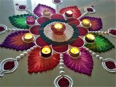 Here is a simple freehand rangoli design for Diwali. It is based on one of my original rangoli designs and I have tried to do some innovation with the placem. Happy Diwali Rangoli, Easy Rangoli Designs Diwali, Rangoli Designs Latest, Simple Rangoli Designs Images, Rangoli Designs Flower, Free Hand Rangoli Design, Small Rangoli Design, Rangoli Border Designs, Rangoli Patterns